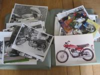 Two folders of motorcycle photos by many hands with much annotation, covers all types of machines from all era's and and includes studio images, a large qty