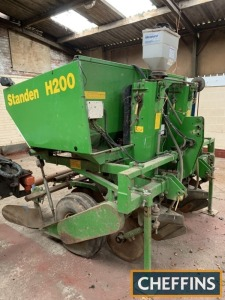 1997 Standen H200 2row mounted potato planter with manual spacing and depth control soil retaining discs, electronic seed miss indicator, belt feed in hopper and rear ridger bodies with trailing bar Serial No. BB2252 Location: Rugeley