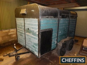 Tandem axle wooden bodied livestock trailer with pipe threader unit and various spares