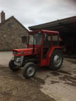c1960s MASSEY FERGUSON 135 3cylinder diesel TRACTOR Fitted with a new cab, foot throttle, PAS, new seat and drawbar. The paintwork is described as being very tidy and the lights are reported to be working. The vendor states that there is a slight diesel l
