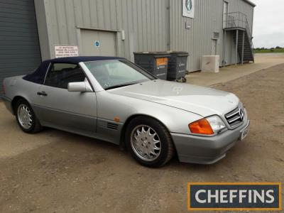 1990 2960cc Mercedes-Benz 300SL convertible Reg. No. H146 WAH Chassis No. WDB129060F21177 Engine No. 10398422001900 Fitted with a straight 6 petrol engine and 4speed automatic transmission, this SL is finished in silver with blue leather interior, both of