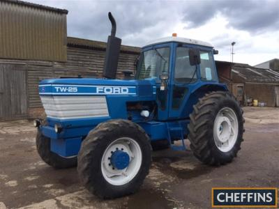 1984 FORD TW-25 6cylinder diesel TRACTOR Reg. No. B516 LRT Serial No. 912217 Fitted with a Q cab, rear inner and out wheel weights, rear PAVT wheels, rear linkage and drawbar on 18.4R38 rear and 14.9R28 front wheels and tyres